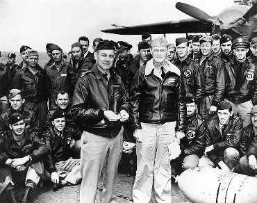 Lt. Col. Jimmy Doolittle with Capt. Mitscher and other Raiders aboard USS Hornet.jpg