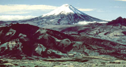 Volcanic Cotopaxi peak rises majestically 120 miles southeast of Quito and can be seen from the city