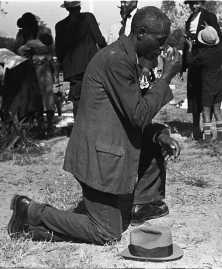 Claude Newman kneeling and praying