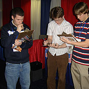 Young conservatives fill out TFP questionnaire at CPAC