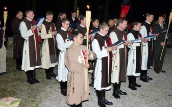 TFP choir members sing during the evening rosary procession.