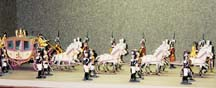 A papal parade, featuring the Vicar of Christ in a gilded carriage surrounded by Swiss and Noble Guards