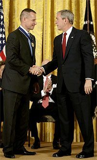 President Bush awards General Peter Pace the Medal of Freedom and praises his complete integrity