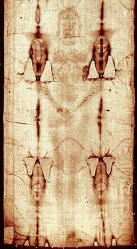 This positive image of the Holy Shroud shows the damage and repairs caused by the 1532 fire