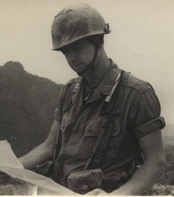 Captain John Ripley studying a map, Vietnam, 1967