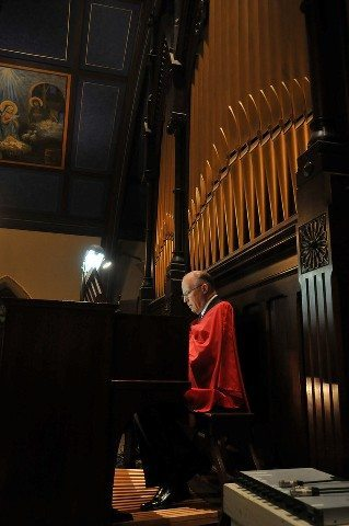Mr. Philip Calder masterfully plays the organ during the Mass