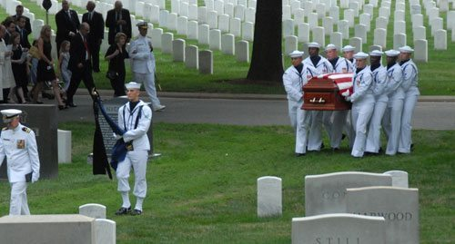 The Navy body bearers then took the coffin from the caisson and marched solemnly to the grave site