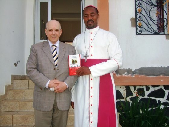 Cameroon — The Most Rev. Sosthène Bayemi, Bishop of Obala, receiving the handbook Preferential Option for the Family—100 Questions and Answers relating to the Synod distributed to all the bishops of the world.