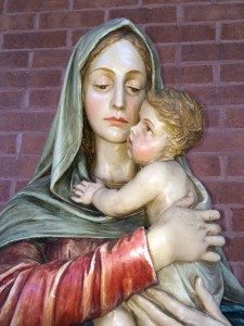 "Madonna with Child statue in Rochester, NY, which ask the question ""Why Me?"""