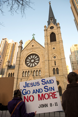 Catholics Pray Outside Cathedral Where Controversial Jesuit Speaks
