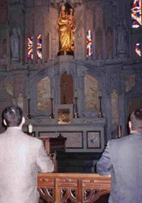 Praying in front of Our Lady of Prompt Succor, a spiritual highlight of any trip to Catholic Louisiana.