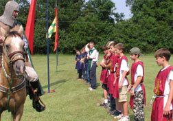 "A knight on horseback rallied his side during the ""medieval games."""