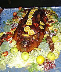 Dinner's main dish was a 159-pound pig, brought out on a richly decorated platter.
