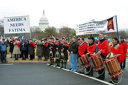 The Holy Choirs of Angels Marching Band with six bagpipers enlivened the event with patriotic music