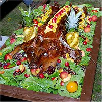 The highlight of this year's feast was a 100-pound pig, roasted over an open fire and richly decorated.<