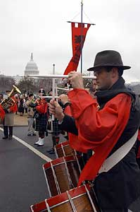 As in years past, the TFP's Holy Choirs of Angels marching band played a selection of patriotic hymns and American marches, to lift the spirits of marchers