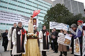 TFP members, wearing the TFP ceremonial habit, escort a pilgrim statue of Our Lady of Fatima at the protest.