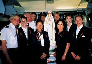 Thomas McKenna recently flew to Austria with the Pilgrim Virgin Statue of Our Lady of Fatima aboard a Northwest flight. The crew could not have been happier to receive such a grace.