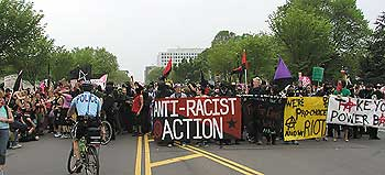 At one point a group of anarchists carrying signs with violent slogans began to harass pro-lifer counter-demonstrators.