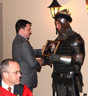 William Sweeney of West Virginia enthusiastically receives a memento of Charlemagne at the closing banquet.