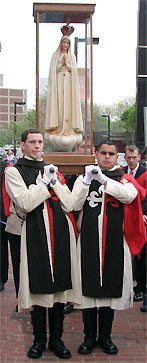 TFP members in ceremonial habit escort Our Lady