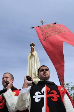 TFP members in ceremonial habit escort Our Lady.