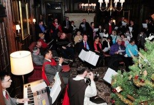 All join in singing Christmas carols led by musicians, including one in the TFP ceremonial habit.