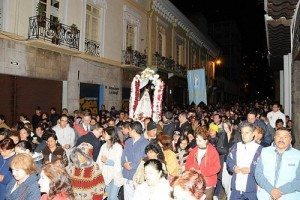 "Crowds pack the streets of central Quito, praying and singing as they carry ""la Virjencita"" in procession"