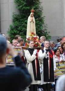 Statue of Our Lady of Fatima during the 2011 Public Square Rosary Rally in New York City, carried by members of The American TFP in ceremonial habit.