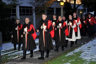 TFP members in ceremonial habit leading the Sunday candlelight Rosary procession
