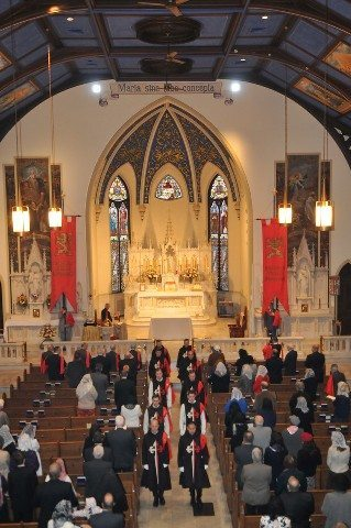 TFP Members in ceremonial habit process out of the sanctuary