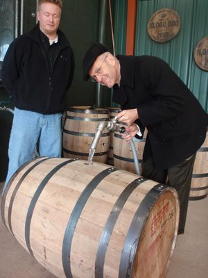 "Pouring ""white lighting"" into a virgin white oak barrel at the Jim Beam distillery"