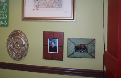 "A picture of the Breakfast Club (right) whose members make up ""the regulars"" and a photo of the late Judge Bob Heaton (center) who enjoyed Mammy's for five years"