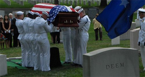 Placing Rear Admiral Jeremiah Denton's coffin on his resting place in Arlington National Cemetery