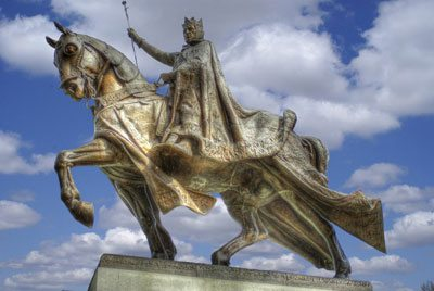 King St. Louis IX stands with many canonized kings and nobles.
