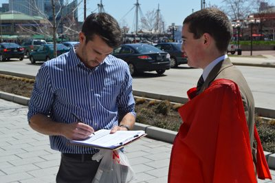 TFP Volunteer collecting petitions from pedestrians
