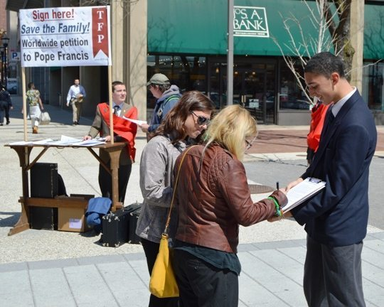 United States — Collecting signatures at a campaign table of the American TFP.