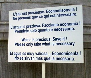 Save water sign in Lourdes.